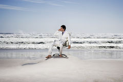 Businessman On Call At Beach Royalty Free Stock Photo