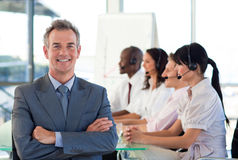 Businessman in a call center Stock Image