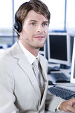 Businessman in a call centre or trading floor Royalty Free Stock Photos