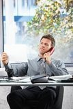 Businessman  on call looking at paper Royalty Free Stock Image