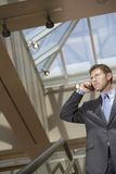 Businessman On Call At Office Staircase Royalty Free Stock Images