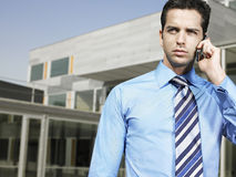 Businessman On Call Outside Office Stock Photos
