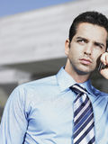 Businessman On Call Outside Office Royalty Free Stock Photography