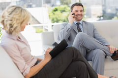 Businessman on call and secretary with diary at home Stock Photos