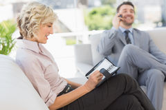 Businessman on call and secretary with diary at home Royalty Free Stock Photo