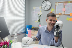 Businessman calling with boxing gloves Stock Photography