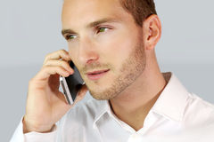 Businessman calling. Man dressed in a white shirt deal goes a phone call royalty free stock photography