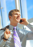 Businessman calling on mobile Stock Photography