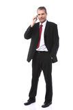 Businessman calling on mobile phone Stock Photography