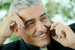 Businessman calling on mobile phone Royalty Free Stock Image