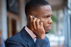 Businessman calling by mobile phone Stock Images