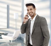 Businessman calling with mobile phone Royalty Free Stock Photos