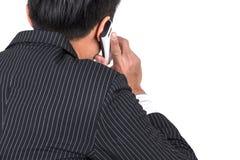 Businessman calling mobile phone Stock Photos