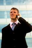 Businessman calling on mobile phone, outdoor. Young businessman calling on mobile phone, outdoor stock photo