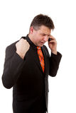 Businessman is calling on the phone. Angry businessman is calling on the phone over white background Stock Photo