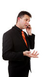 Businessman is calling on the phone. Over white background Royalty Free Stock Photography