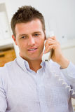 Businessman calling on phone. Business man working at home, calling on phone Royalty Free Stock Photos