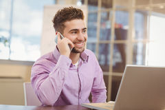 Businessman calling on phone in office Stock Images