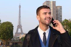 Businessman calling by phone from Paris.  stock photography