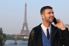 Businessman calling by phone from Paris.  stock photos