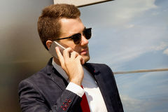 Businessman calling on the phone the street stock photo