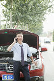 Businessman Calling for Roadside Assistance Royalty Free Stock Image