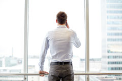 Businessman calling on smartphone in office Stock Image