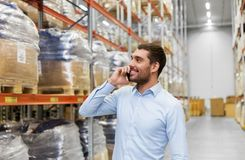 Businessman calling on smartphone at warehouse Stock Photography