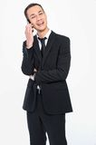 Businessman calling with a smile Stock Photography