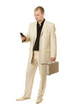 Businessman calls. Businessman with mobile phone. White background Stock Photos