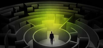 Businessman choosing between entrances in a middle of a dark maze royalty free stock photos