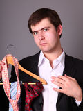 Businessman can't select a tie Royalty Free Stock Photos