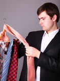 Businessman can't select a tie Stock Images
