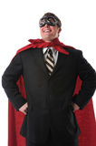 Businessman With Cape and Goggles. Businessman with red cape and goggles smiling confidently stock images