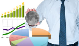 Businessman capture the moon Stock Photo