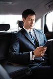 Businessman in a car Royalty Free Stock Photo