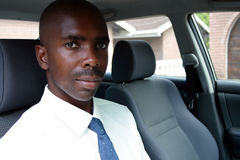 Businessman in car. A young african businessman in his car Stock Photo