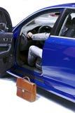 Businessman in car. Businessman buying good car in auto shop Royalty Free Stock Photos