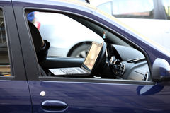 Businessman in a car. A businessman inside a car with laptop stock images