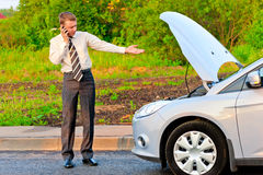 Businessman in a car crash Stock Photos