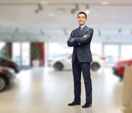 Businessman or car dealer over auto show Stock Photo