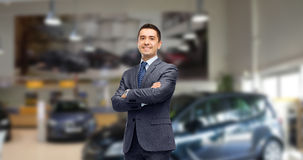 Businessman or car dealer over auto show Royalty Free Stock Photo