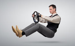 Businessman car driver with a steering wheel royalty free stock image
