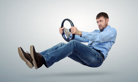 Businessman car driver with a steering wheel. On background Royalty Free Stock Photography