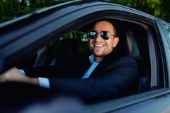 Businessman in car driving royalty free stock images