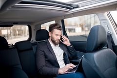 Businessman in the car Royalty Free Stock Photo