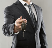 Businessman with car key Stock Image