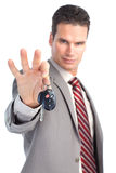 Businessman with car keys Stock Images