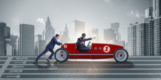 The businessman car pushing in teamwork concept Stock Photography