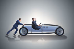 The businessman car pushing in teamwork concept Stock Images